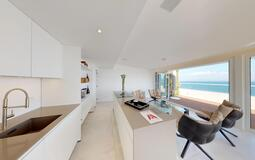 Penthouse in Illetes - Upper living area with kitchen and sea views