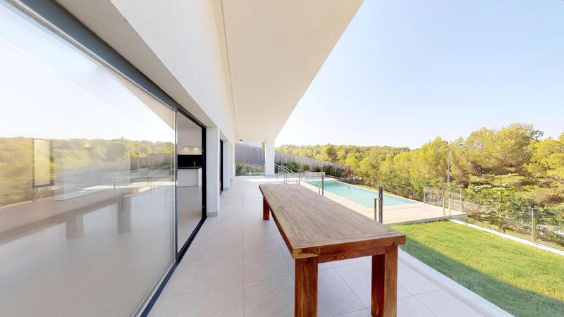 Villa in Cala Vinyes - Covered terrace overlooking pool and garden