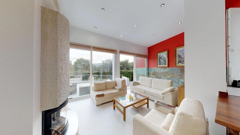 Villa in El Toro - Port Adriano - Living room with fireplace